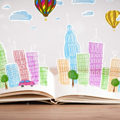 Book laying open with graphic representation of city building bursting from the pages
