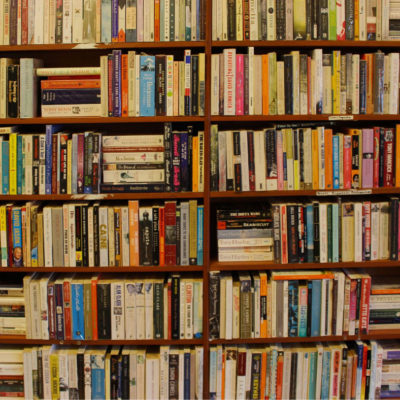 Hundreds of books stacked on book shelves