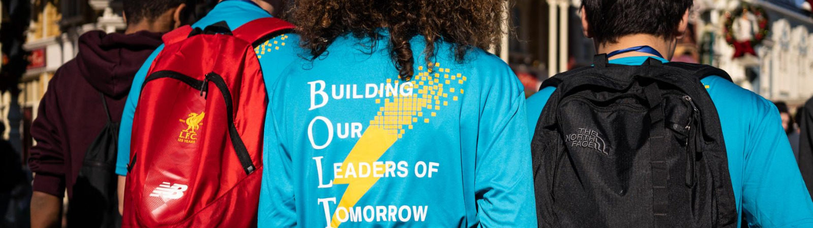 """Back of student's shirt featuring BOLT program text """"building our leaders of tomorrow"""""""