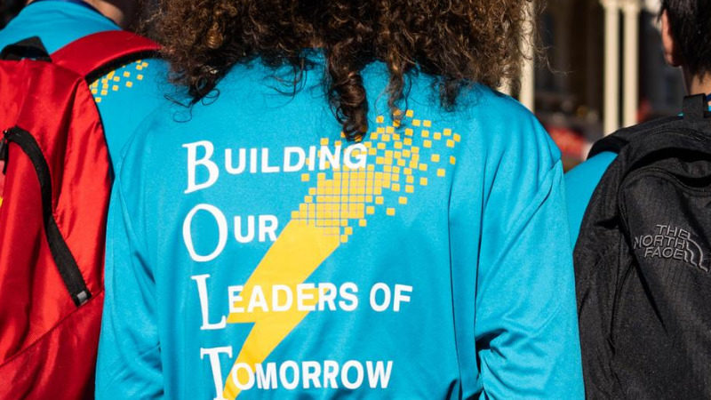 "Back of student's shirt featuring BOLT program text ""building our leaders of tomorrow"""
