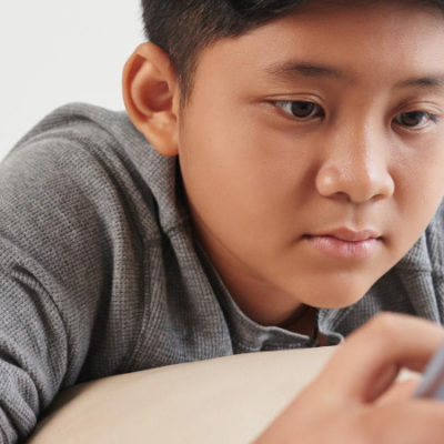 Child reading on a tablet