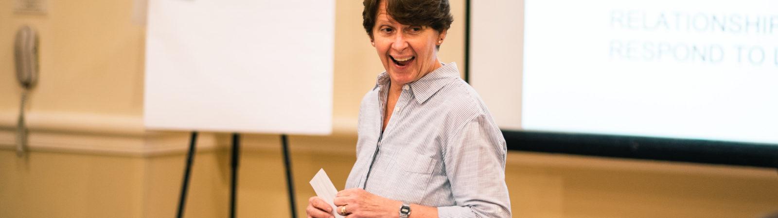 Photo of facilitator teaching courses